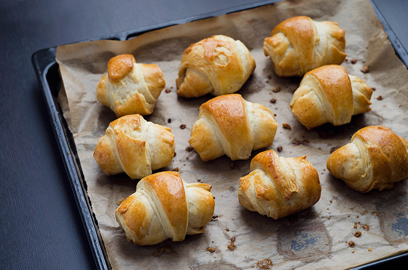 Mini croissants aperitif with onion confit and parmesan cheese